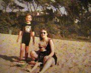 Vic and her boys on the beach.