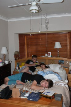 Boys lying with Vic before Chris' arrival